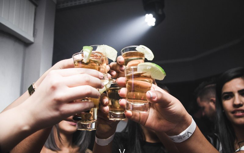 people holding up Tequila Shots