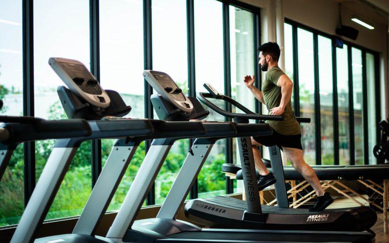 man running in gym