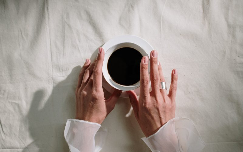 person holding coffee
